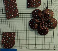 Tutorial on how to sew a 5 petal ribbon flower.