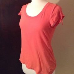 Cute Athleta Tee Perfect condition and super cute! Has little strings on the sleeves. I wash and sanitize all items before sending them! If you have any questions about this item feel free to ask!  Athleta Tops Tees - Short Sleeve