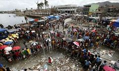 Income gap poses biggest threat to global community, warns WEF | Victims queue for food and water after super typhoon Haiyan in Tacloban city, Philippines. The WEF has identified inequality, extreme weather and unemployment as the biggest threat to the global community. Photograph: Erik De Castro/Reuters
