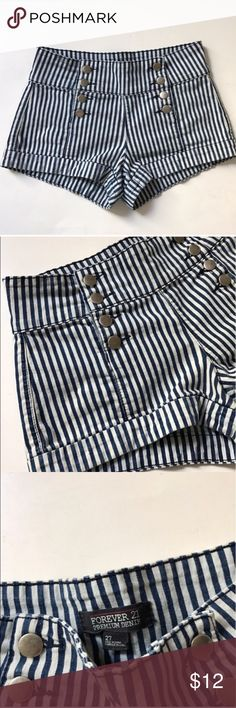 """Forever 21 striped shorts Forever 21 striped shorts. Size 27. Inseam measures 2"""". Rise measures 9"""". Waistband measures 28"""". Two pockets. Pull on style or the buttons can be undone. Blue/ gray combo. Two small snags on the backside. Overall I'd say this is in very good used condition! 🚫NO TRADES🚫 💲Reasonable offers accepted💲 💰Ask about bundle discounts💰 Forever 21 Shorts Jean Shorts"""