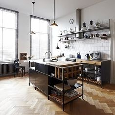 open shelves, raised benches, herringbone wooden floor, industrial lamps