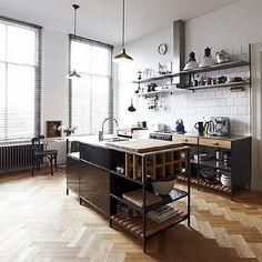 open shelves, raised benches, herringbone wooden floor, industrial lamps