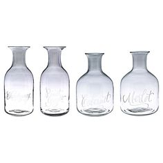 With graceful silhouettes and elegant lettering etched by hand, these petite carafes make charming vessels for your favorite vintages.