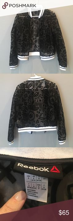 Reebock Sheer Velvet Burnout Bomber Jacket Sheer mesh cropped bomber jacket with all over velvet burnout pattern of stars, eyes, diamonds, brass knuckles, lightning bolts, and other kickass symbols. Neckline, cuffs, and hem feature stretchy white athletic stripe Knit bands. Very light pilling on a few places along these bands, but otherwise no signs of wear and in overall excellent condition. Reebok Jackets & Coats