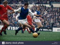 30th August 1969. Sheffield Wednesday defender Gerry Young is chased by Liverpool's Roger Hunt.