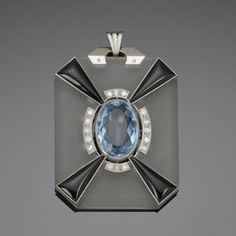 An art deco rock crystal, enamel, onyx and diamond pendant / circa 1920 / It is believed that this pendant is by the art deco jeweller, Amié Arnould
