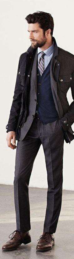 Men's Multi colored Plaid Tie, Light Blue Dress Shirt, Navy Cardigan, Charcoal Dress Pants, Charcoal Blazer, Black Military Jacket, and Brow...