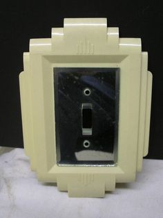 ART DECO BAKELITE AND MIRROR SWITCH AND OUTLET COVER