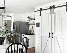 Double-door single-lane bypass barn door on a single rail. Hardware Rustic Farmhouse Track Kit - Powder Coated BLACK - Doors NOT INCLUDEDDouble-door single-lane bypass barn door on a single rail. Barn Door Closet, Barn Door Track, Double Sliding Barn Doors, Sliding Barn Door Hardware, Door Hinges, Bypass Barn Door, Barn Door Handles, Rustic Hardware, Ranch House Plans