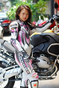 Asian girl in leather racing jumpsuit