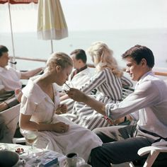Alain Delon offers Romy Schneider a cigarette at Cannes, 1962 – Picture: Sipa Press / Rex Features