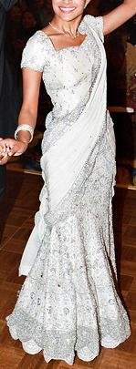 My first anniversary with my husband I'm going to do it American style and wear a white sari or just buy an actual wedding dress. Decisions...