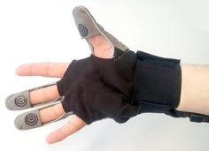 "SEM™ Glove (Soft Extra Muscle Glove) from Bioservo. Assistive technology for a weak hand grip. ""The fingertips in the SEM Glove are equipped with force sensitive sensors that register when the user grasps an object. A microcontroller calculates the desired added force and controls small engines that in turn regulates tendons connected to the fingertips of the glove. The tendons pulls the fingertips and an extra force is created."" The glove is powered with two lithium-ion batteries."