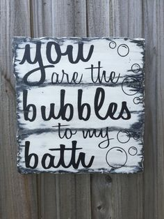 Hand-made wooden sign reading You Are The Bubbles to my Bath. Measures 10-5/8 x 10 and comes equipped with hanging hardware. This would be an excellent addition to your bathroom decor. Hand-painted and given a distressed look. The size and colors can be customized to suit your needs also. Just let us know