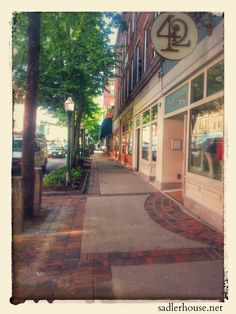 Main Street in Rockland, Maine. One of my favorite places. So much going on, yet it retains its historical charm. Click through to find out how you can stay with us at Sadler House just steps from all this and without service fees! #Travel #Photography #Maine #NewEngland #vacation #vacationideas #mainstreet #antique #vintage
