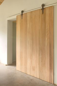 Cedar Barn Door on salvage rollers and track.