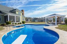 Traditional Swimming Pool with Pool with hot tub, exterior tile floors, Gazebo, Fence