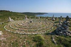 New age meditational labyrinth on the Kamenjak coast and the blue sea
