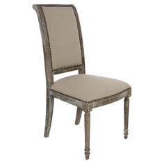 Perfect pulled up to your dining table or writing desk, this wood-framed side chair showcases an upholstered seat and classic nailhead trim.