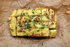 Easy recipe to prepare a homemade Spanish tortilla with ham. This baked tortilla style omelette is made with potatoes, eggs, onions, ham, garlic, and jalapeños (or bell peppers).