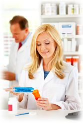 Bioidentical hormone therapies being compounded by pharmacists in a compounding pharmacy.