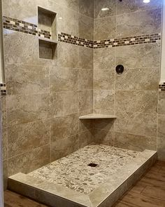 12x24 tile shower with river rock pan. Trident Tile and Stone Design Studio