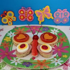 Colorful and healthy butterfly sandwich for kids. Made with bread, ham, cheese, tomatoes, egg, radish and surimi.  #sandwich, #butterfly