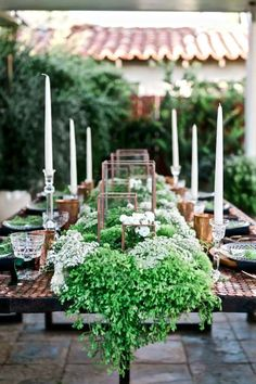 For the centerpiece, a lush Irish 'garden' running down the middle, use two types of moss, baby tears, pansies, white alyssum, green dianthus, Queen Anne's lace & white garden roses candles in rustic squares down the middle and tall ones down the edge create elegant interest