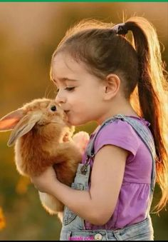 Sweet little girl and bunny cute andor funny pets children.