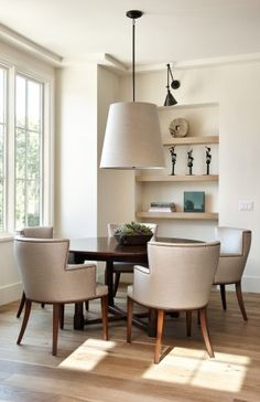 Natural materials. Love the linnen looking shade of the big pendant light, neutral colours, light hardwood floors.