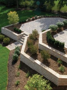 slab steppers, natural landscaping, and @unilock pavers give this ... - Unilock Patio Designs