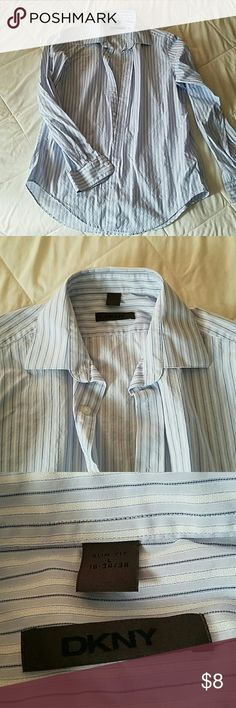 Cute Button down blouse Light blue and white button down blouse DKNY in excellent condition. DKNY Tops Button Down Shirts