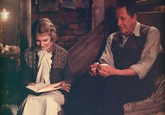 In this scene, you can see Hans and Liesel bonding. Liesel learns to read the book she stole. She becomes closer to Hans.