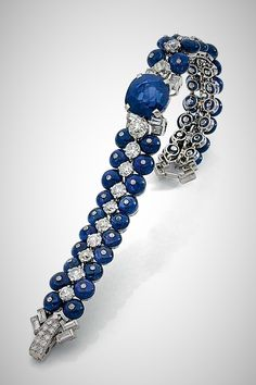 An Art Deco sapphire, diamond, platinum and white gold bracelet by Cartier.