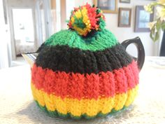 Mum's knitting -- Mum's Rastafarian knitted tea cosy -- New Zealand -- August 2013 Tea Cosy Knitting Pattern, Knitting Patterns, Tea Cosies, Cozies, Tea Cozy, August 2013, Knitted Hats, Teapots, Color