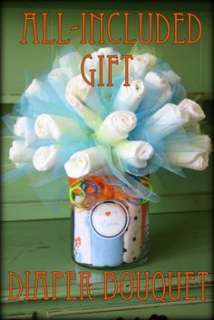 """Like Mom and Apple Pie: Baby Shower Gift-Diaper Bouquet DIY and Tutorial- burp cloths in vase and rattle for the """"bow"""""""