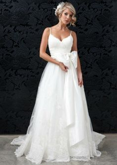custom made spaghetti strap wedding dress with bow from weddingdressbee- a smaller bow would be perfect