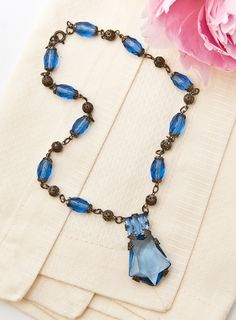 Art Deco Czech Blue Topaz Necklace c. 1920s. Art deco brass and blue topaz colored glass Czechoslovakian necklace.