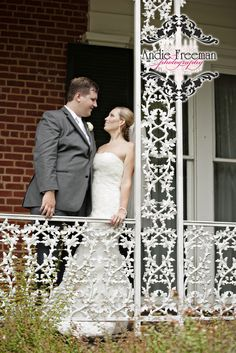 Bride and groom portrait on porch.  Classic Southern Wedding at art gallery and historic home.   Photography:  Andie Freeman Photography www.TheAthensWeddingPhotographer.com Event Coordinator: www.WildflowerEventServices.com Event design and Catering:  Mama's Boy Venue:  Lyndon House Arts Center