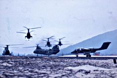 HMM 364 (Purple Fox) CH 46s lift off at Marble Mountain While VMO-2 OV-10 Bronco Waits its Turn 1968