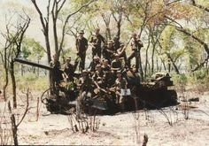 South African 61 Mech Bn. Sitting on the wreck of a T55 during the Bush War, 1987