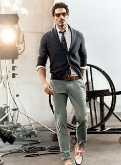Shop this look for $232: http://lookastic.com/men/looks/tie-and-dress-shirt-and-shawl-cardigan-and-chinos-and-belt-and-boat-shoes/751 — Navy Polka Dot Tie — White Dress Shirt — Charcoal Shawl Cardigan — Grey Chinos — Brown Leather Belt — White and Red and Navy Boat Shoes
