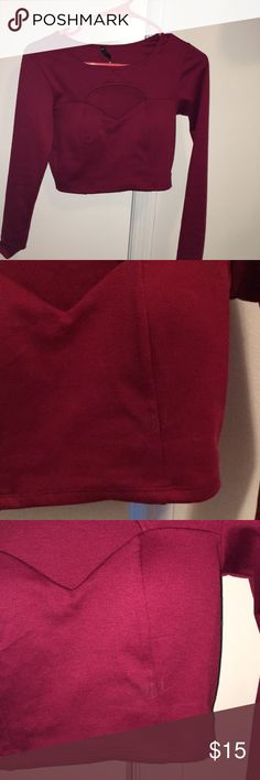 Burgundy Long sleeve crop top Adorable size small crop top! So cute with a leather skirt or high waisted jeans. It's just a bit too small on me. Would fit a B/C cup well. There's a small discoloration pictured in two pics (one with and one without flash) can't even tell it's there, idk what it is. I just washed it. Worn once. Last pic is just showing the texture. It's kinda thick material. Love Culture Tops Crop Tops