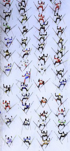 An aerial view shows cross-country skiers climbing a hill