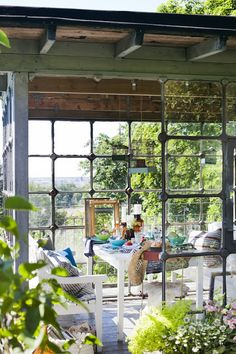 Here is the idea.  A plant room on the outside south corner.  Accessible to my kitchen.  Love the iron window frames but may be able to use old recycled mismatched as well?  Tile floor with drain.  Would love a sink for work and possible fountain for atmosphere.      room...Greenhouse