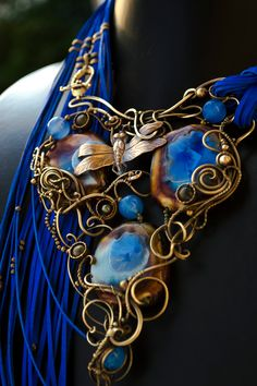 020701 052 by DARiyaKUTEPOVA necklace equipment gear magic item   Create your own roleplaying game material w/ RPG Bard: www.rpgbard.com   Writing inspiration for Dungeons and Dragons DND D&D Pathfinder PFRPG Warhammer 40k Star Wars Shadowrun Call of Cthulhu Lord of the Rings LoTR + d20 fantasy science fiction scifi horror design   Not Trusty Sword art: click artwork for source