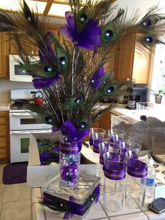 30 Lovely Peacock Wedding Centerpieces Ideas That Have An Unique Style - Celebrating your wedding with a peacock theme is rich in two ways. The first is the symbolism of the bird itself: noble, dignified, graceful, beautifu. Peacock Wedding Centerpieces, Masquerade Party Centerpieces, Mardi Gras Centerpieces, Masquerade Theme, Mardi Gras Decorations, Diy Wedding Decorations, Purple Centerpiece, Balloon Centerpieces, Centerpiece Ideas