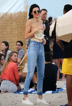 Relaxed: Kendall Jenner was spotted enjoying a glass of wine on the beach in Miami on Sund...