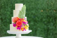 Tropical gardens make us dream of Hawaii but relish our beautiful San Diego coast!  This gorgeous buttercream wedding cake was embellished with fresh tropical flowers & palms by our lovely Lauren and set up at Bali Hai Restaurant (of course).   Florals provided by: Matteson's Florist   Photo shot by: https://www.cavinelizabeth.com/