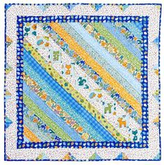 Quickly piece this quilt for a special baby with the help of an assortment of fun precut strips. Jellyroll Quilts, Scrappy Quilts, Easy Quilts, Mini Quilts, Patch Quilt, Rag Quilt, Quilt Blocks, Quilt Baby, Quilting Projects